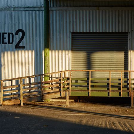 Outside by the main entry to Shed 2